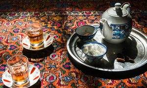 Tea set on a carpet, in Iran.