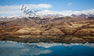 'A paradise of dirt tracks and waterfalls': the Alborz mountains with Lake Taleghan in the foreground.