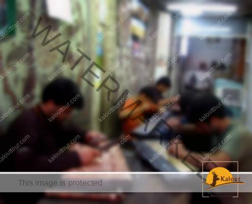 A group of craftsmen working in a metalworking workshop in Esfehan