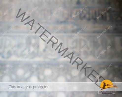 Islamic art if form of painted inscription of Koranic verses, holy names, etc.