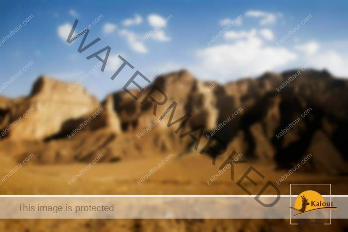 The highway from Shiraz to Yazd follows historical trade routes, passing the same desert mountains as the camel caravans of previous centuries.